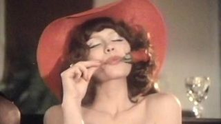 Red rose and red hat in a sexy video